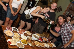 """Three travel buddies pose for a picture above the hostel's """"local food tasting"""" event."""