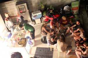 A BBQ outside at Miyajima hostel lets backpackers and flashpackers mix and mingle.