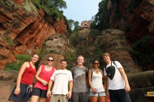 Flashpackers and backpackers stand in front of the Giant Buddha in Leshan, China.