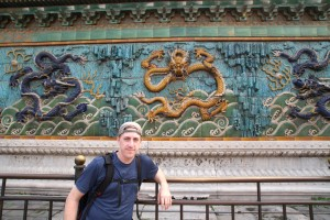 In front of the 9 Dragon Wall at the Forbidden City in Beijing.