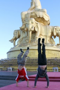 Ben and Ricky do their thing - a hand stand in front of the huge golden buddha on top of Mt. Emei.