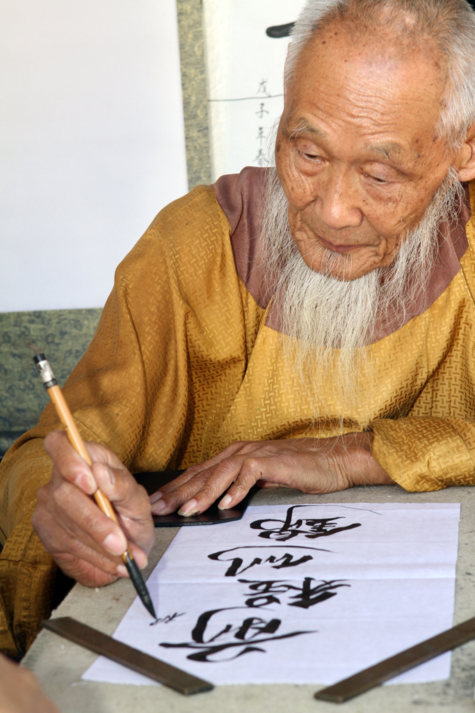 A master of Chinese Calligraphy tells your fortune and then expertly puts it down on paper for you.