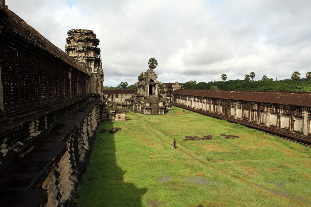 A boy walks through the courtyard between the first and second tiers at the Angkor Wat temple complex in Siem Reap, Cambodia.