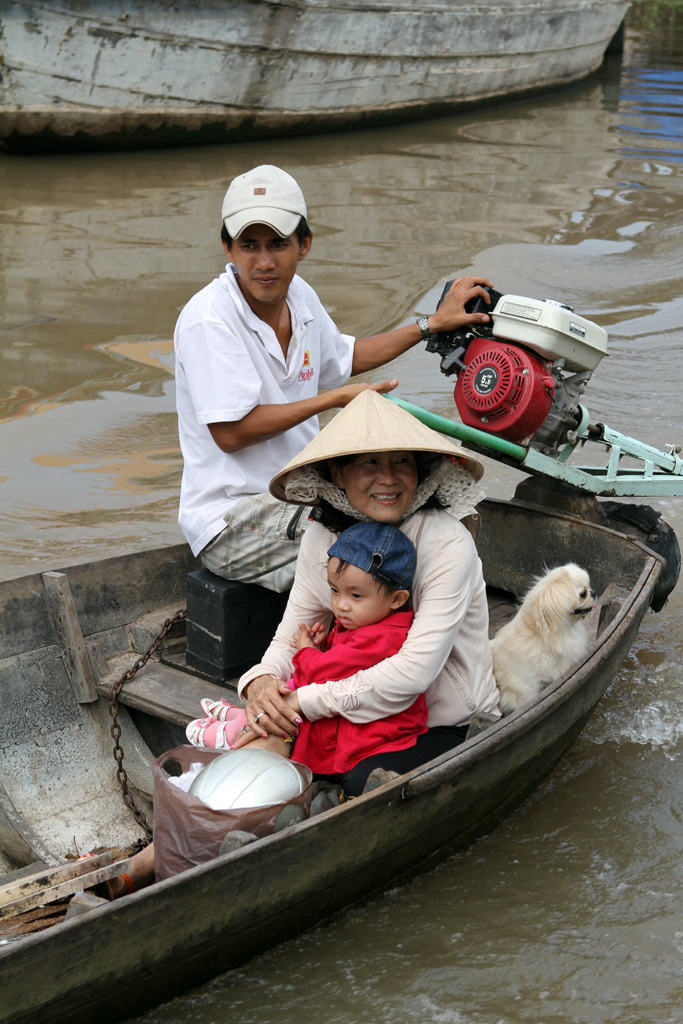 A family floats down the Mekong in the Mekong Delta region of Vietnam.