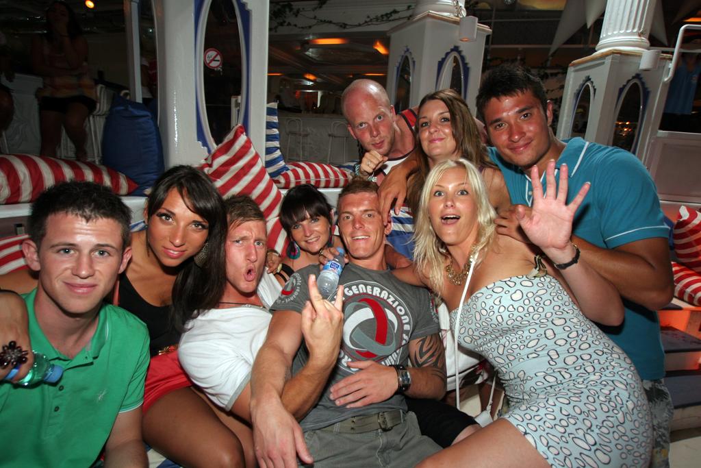 A Group posing at club Es Paradis in Ibiza