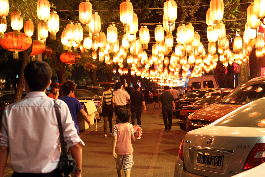 Chinese people walk down Ghost Street at night in Beijing, China