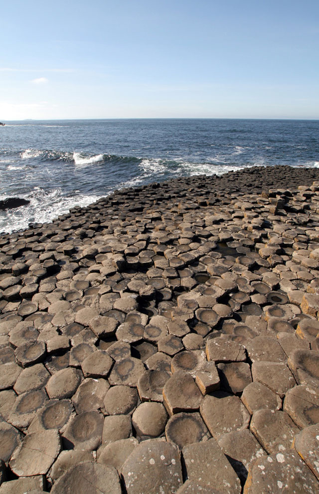 The hexagonal outcroppings of the Giant's Causeway meet the ocean in Northern Ireland.
