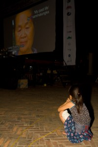 A little local girl watches the opening short films that were made in and around Luang Prabang specifically for the festival.
