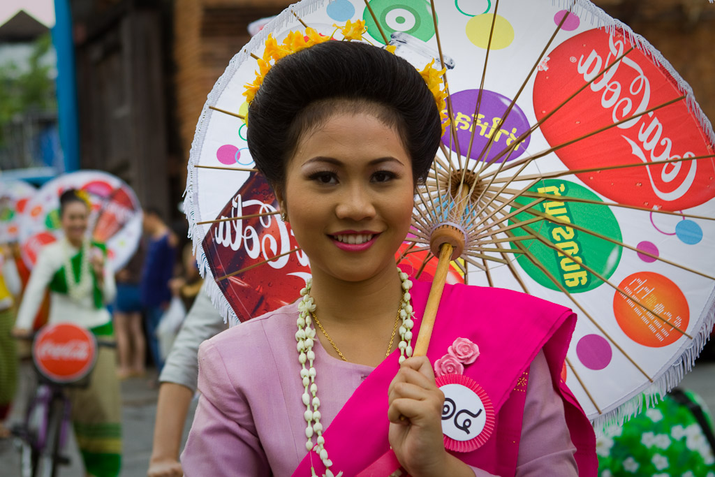 One of the events during Songkran is a parade of women on bikes carrying Umbrellas.
