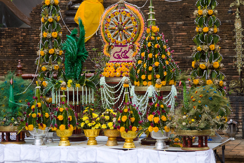 Huge arrangements of flowers and banana leaves are given as offerings.