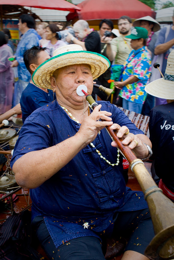 This parade participant blows his own horn as he rides down Chiang Mai walking street during the Songkran Festival.