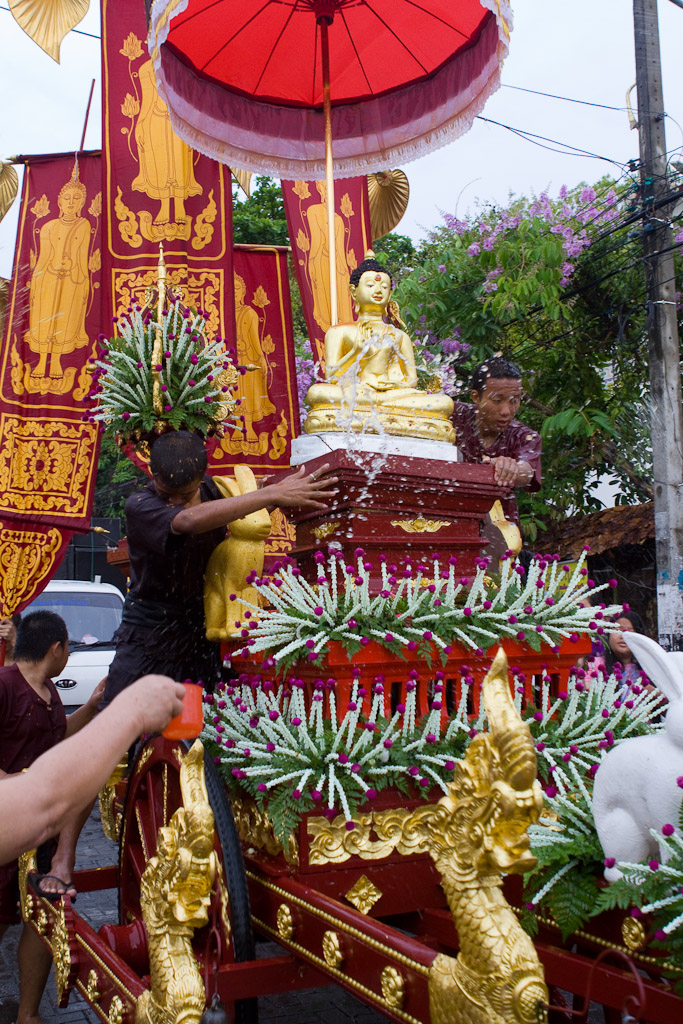 Scented water is thrown at this parade float carrying an image of the Buddha in the parade.
