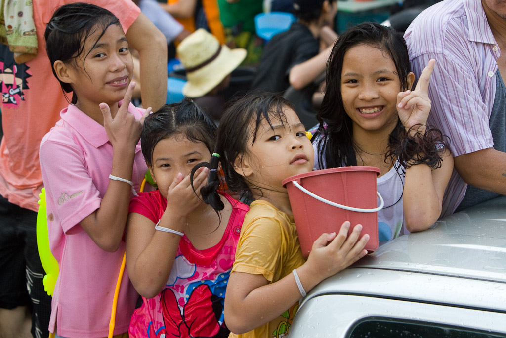 Songkran is certainly a festival for all ages. These four ride in the back of a truck with the rest of their family.