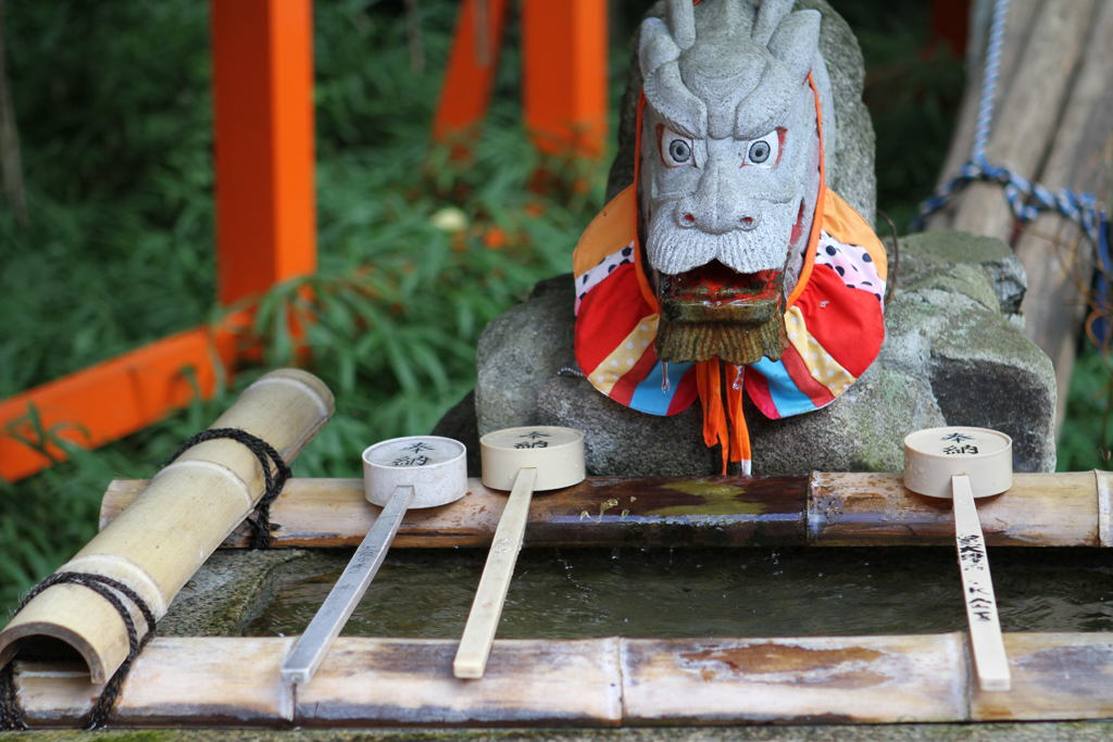 At the entrance to all temples in Japan there is an area where you can do a purification ritual using the wooden cups and water provided by the fountain.