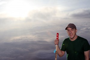 On top of Mt. Fuji with a sea of clouds in the background.