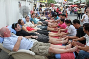 Members of Team Chiang Mai (a loose group of travelers living in Chiang Mai) getting foot massages at the Sunday Market.