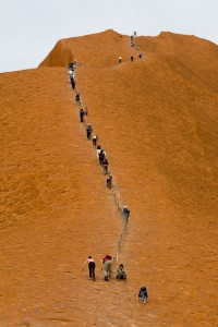 The climb up Uluru is assisted with a low chain, but still a difficult climb that causes many deaths each year.