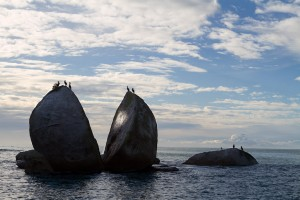 "A rock formation in Abel Tasman known as the ""split apple"" and used frequently by New Zealand tourism brochures."