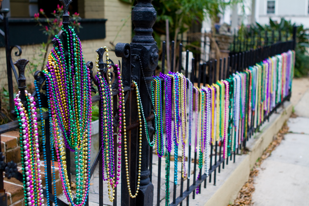 Mardi Gras Beads on a cast iron fence