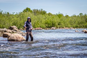 Dima demonstrates how you throw your line up river and let the current slowly take the fly downstream.