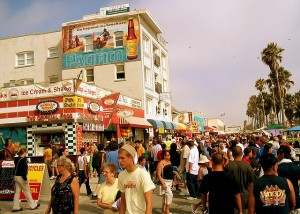 The Venice Beach Boardwalk draws large crowds and is great for people watching in Los Angeles.  Image by Oz Mendoza via Flickr.