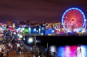 The carnival atmosphere of the Santa Monica pier in Los Angeles attract locals and tourists alike. Photo by Steven Bevacqua via Flickr.