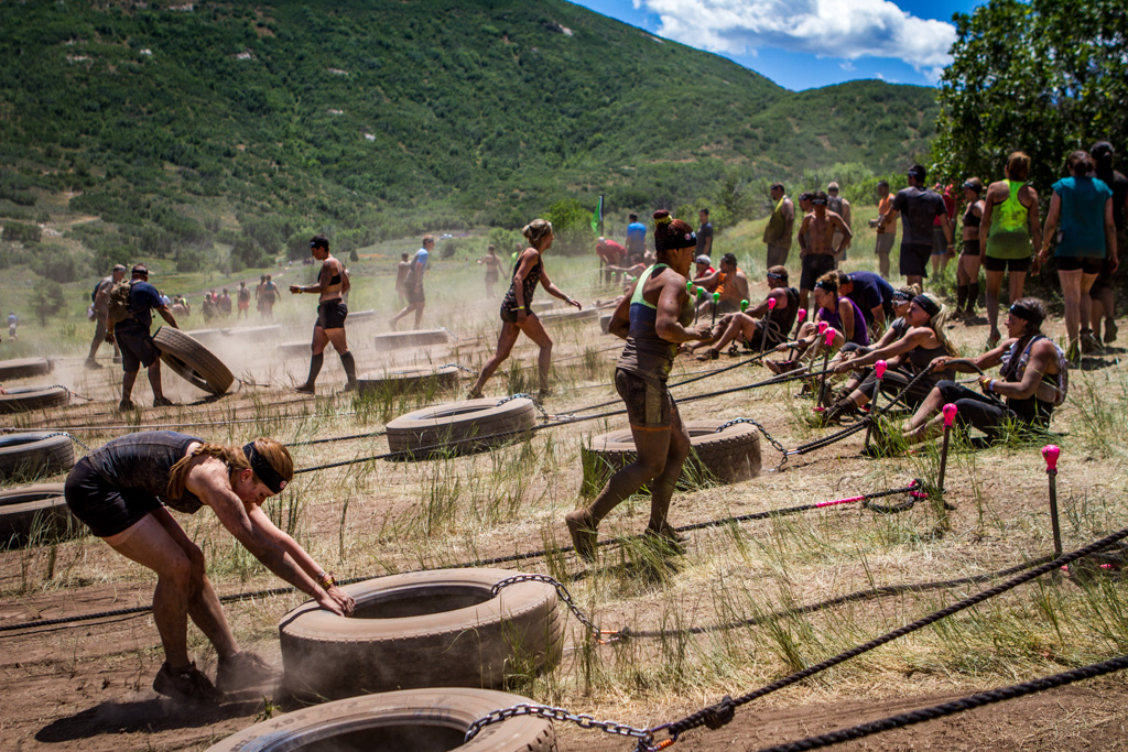 The tire pull obstacle involves dragging a tire a specified distance and then dragging it back via the attached rope.