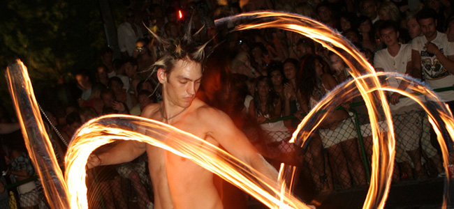 A fire dancer entertains the crowd at Ibiza's Zoo Project.