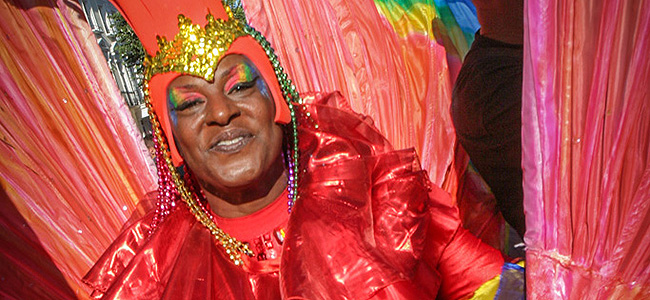 The very colorful costume of a Notting Hill Carnival participant. The festival takes place in late August on the streets of Notting Hill in London.
