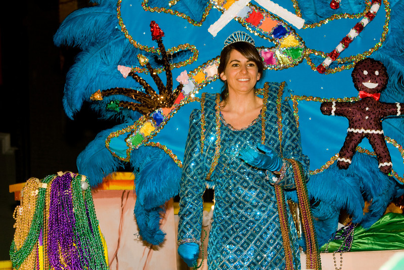 Women in elaborate, colorful costumes are the focus of many floats during Mardi Gras.