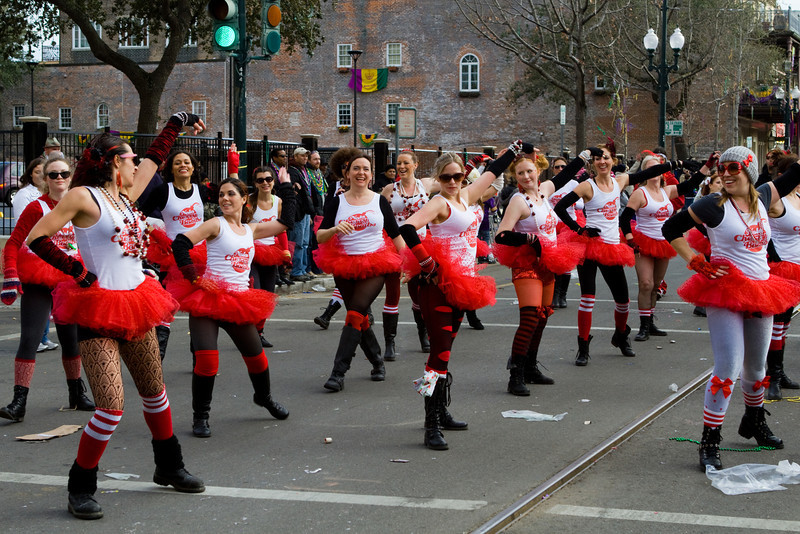 A roller derby group dancing down as part of a parade.
