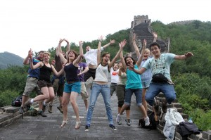 Backpackers jump high in the air on the Great Wall of China in Beijing.