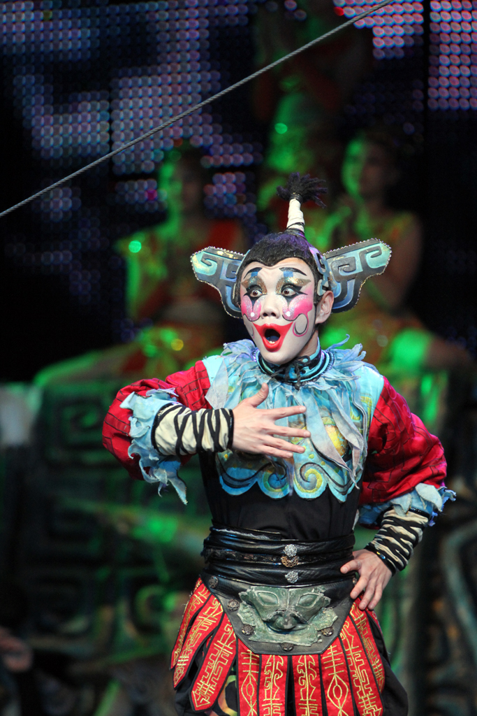 The clown at the Chinese acrobatic show in Beijing acting shocked that one of the performers is able to perform an amazing feat.