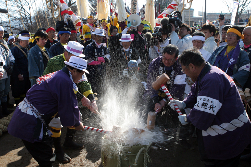 A barrel of Nihonshu (Japanese Sake) is hammered open to start the day's festivities at the Ombashira festival in rural Japan.