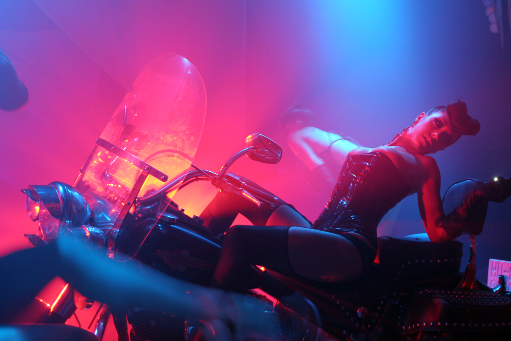A dancer at Pasha on a motorcycle.