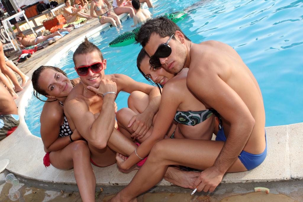 Some clubbers at Zoo Project hang out by the pool
