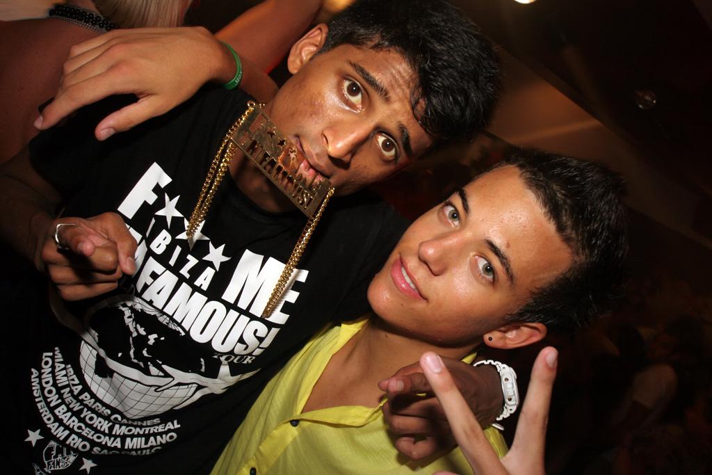 Two guys pose at F**K Me I'm Famous at Pasha in Ibiza