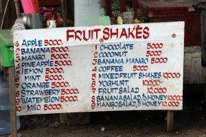 A sign listing the different fruit shakes and their prices, catering almost exclusively to backpackers.