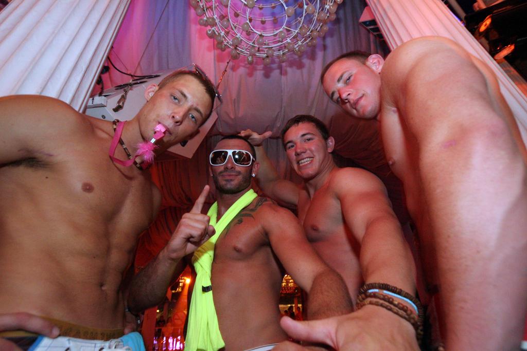 A group of guys pose at Es Paradis
