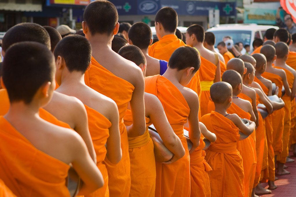 The monks stand in line waiting on alms during the presentation at the start of Songkran.