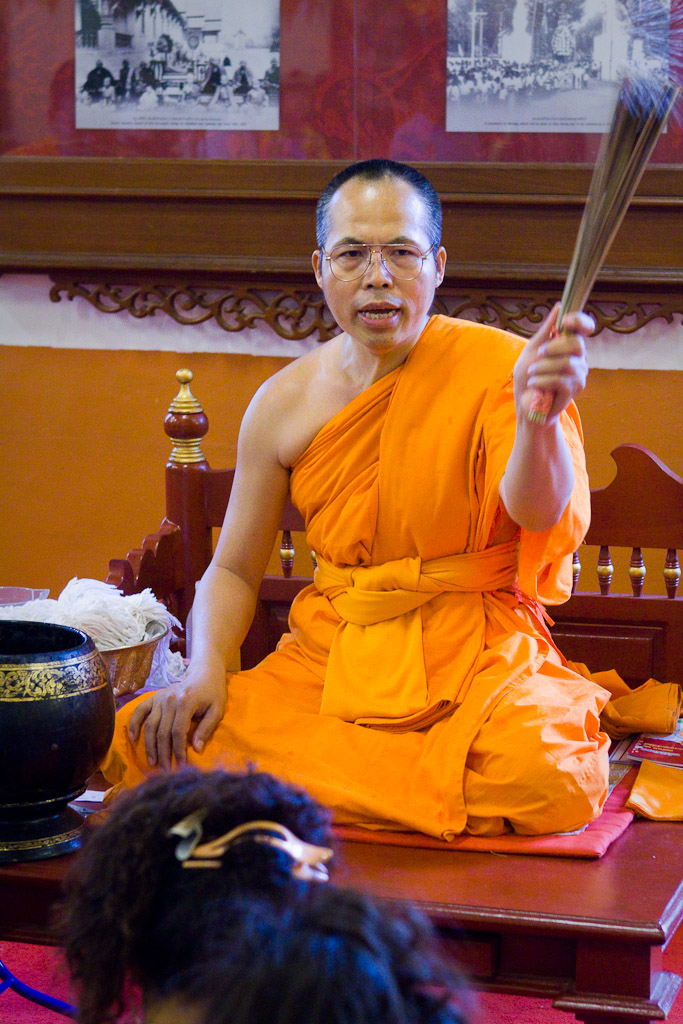 A monk blesses worshipers at Wat Phra Singh in Chiang Mai during Songkran.