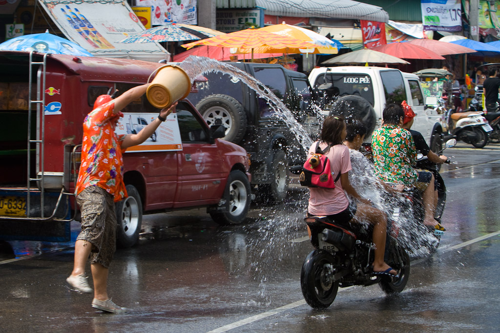 A water demon douses a passing motorist.