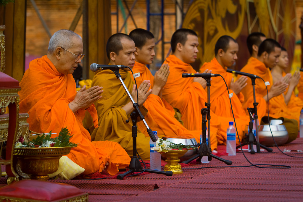 The elder monk leads the prayer as part of the Songkran new year alms presentation.