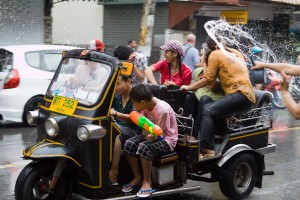 A tuk tuk races through the water gauntlet that is the streets of Chiang Mai during Songkran.
