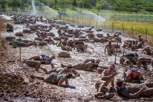 A long mud crawl under barbed wire is the last major obstacle of most Spartan races.