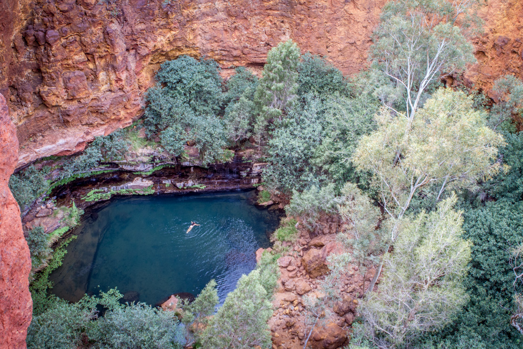 A small pool of water at the base of a series of gorges in Karijini National Park, Australia.