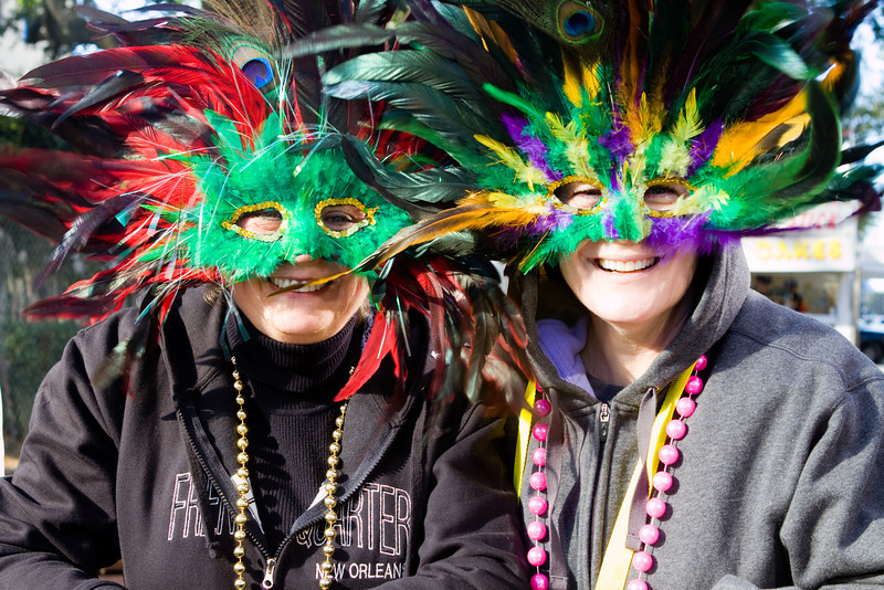 Masked revelers enjoy a Mardi Gras Parade